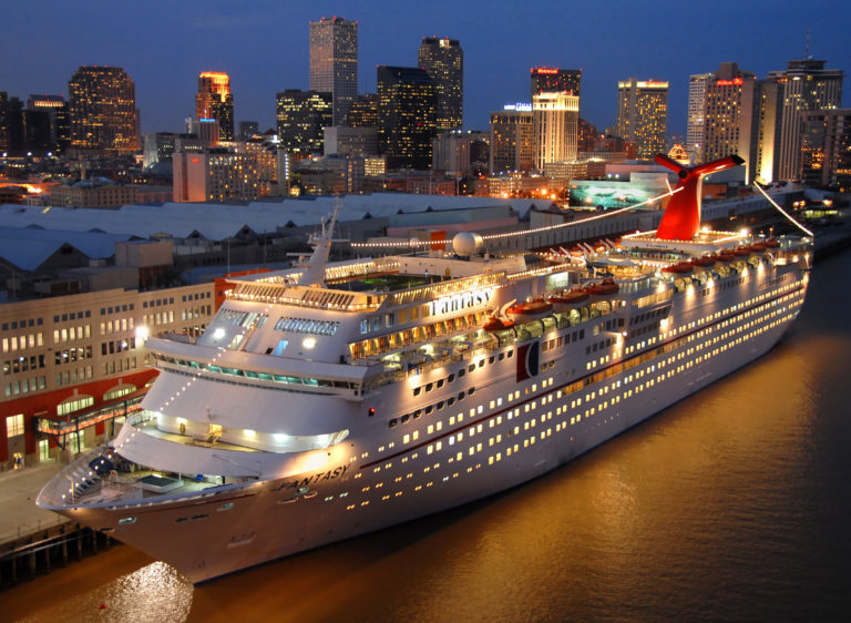 Carnival Cruise LinesÕ 2,056-passenger Fantasy is lit up, while docked at the Port of New Orleans. The ship operates year-round four- and five-day Mexico voyages from New Orleans, marking the lineÕs return of service from the popular homeport. Photo by Andy Newman/Carnival Cruise Lines